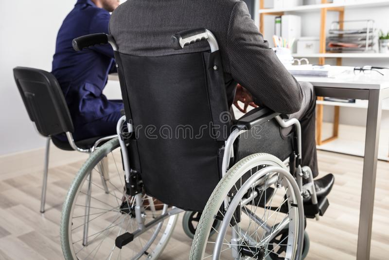 Hombre de negocios Sitting In Wheelchair foto de archivo libre de regalías