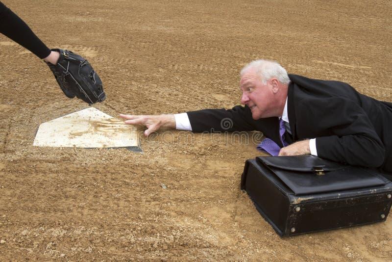 Hombre de negocios Sliding para el hogar foto de archivo