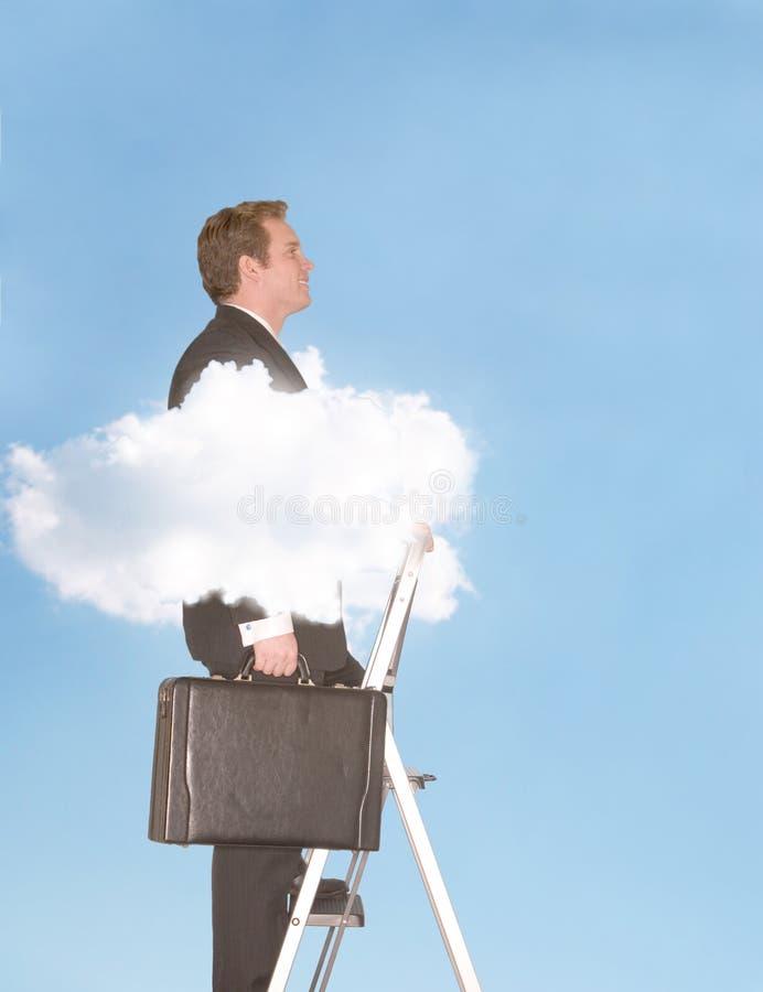 Hombre de negocios sobre las nubes imagenes de archivo