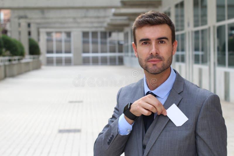 Hombre de negocios sofisticado que ofrece sus servicios imagenes de archivo
