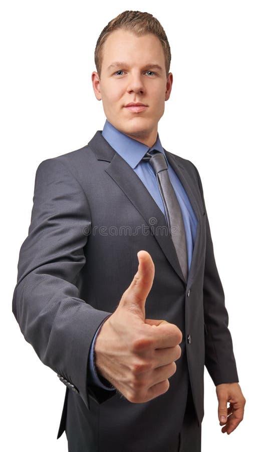Hombre de negocios sonriente acertado atractivo joven aislado con el pulgar para arriba Concepto del negocio para el anuncio imagen de archivo
