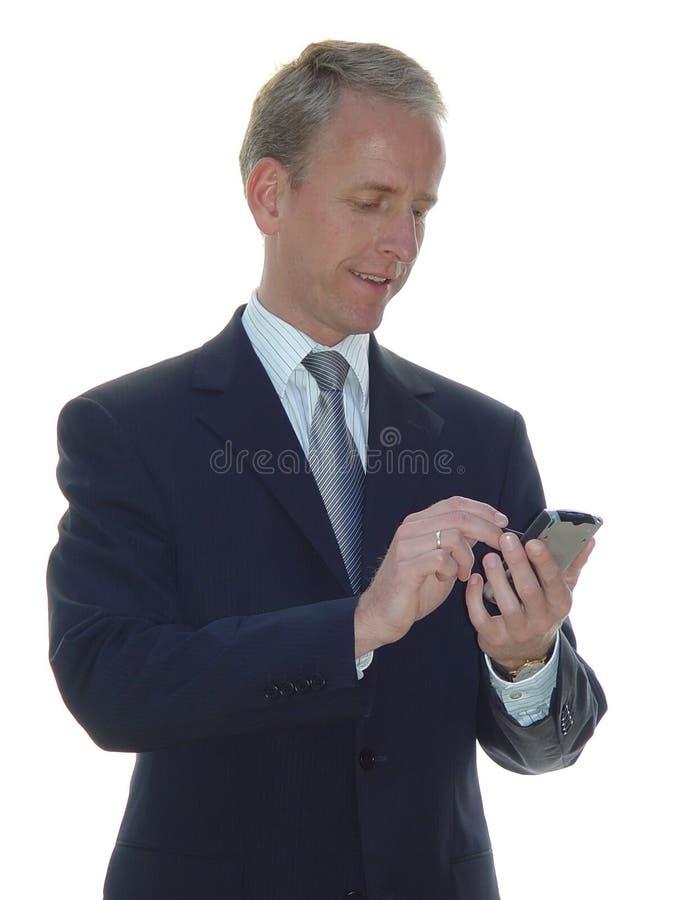Hombre de negocios sonriente con PDA imagenes de archivo