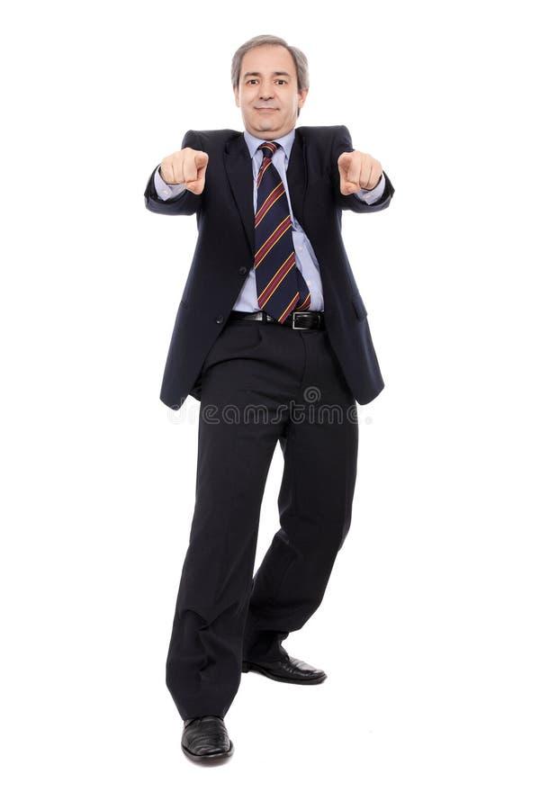 Hombre de negocios sonriente con señalar de las manos fotos de archivo libres de regalías