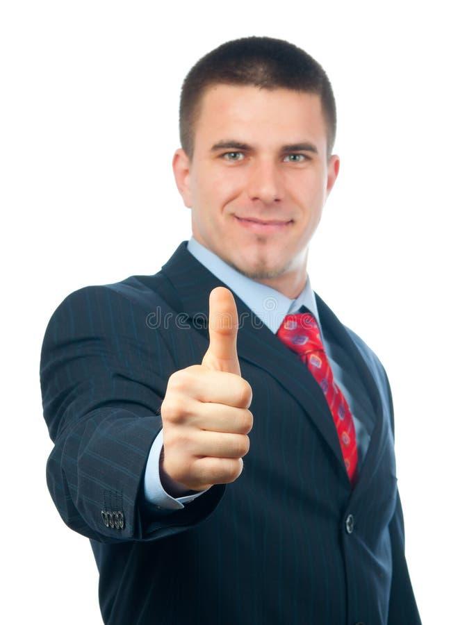 Hombre de negocios sonriente hermoso que muestra los pulgares para arriba fotos de archivo