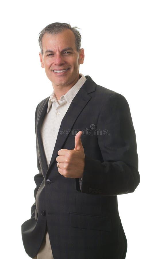 Hombre de negocios sonriente que da los pulgares para arriba imagen de archivo