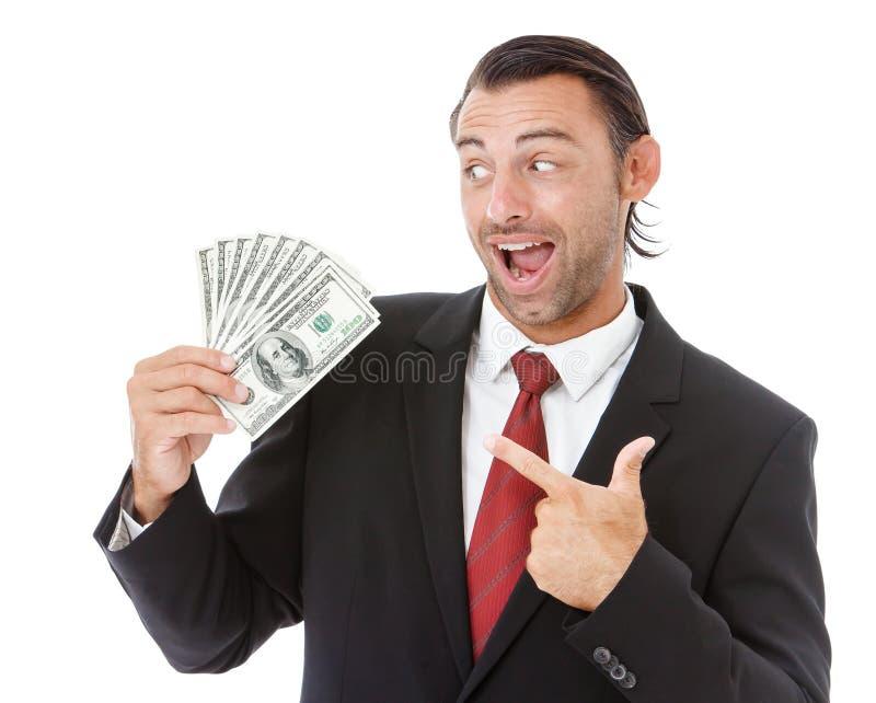 Hombre de negocios sonriente que sostiene el dinero fotografía de archivo libre de regalías