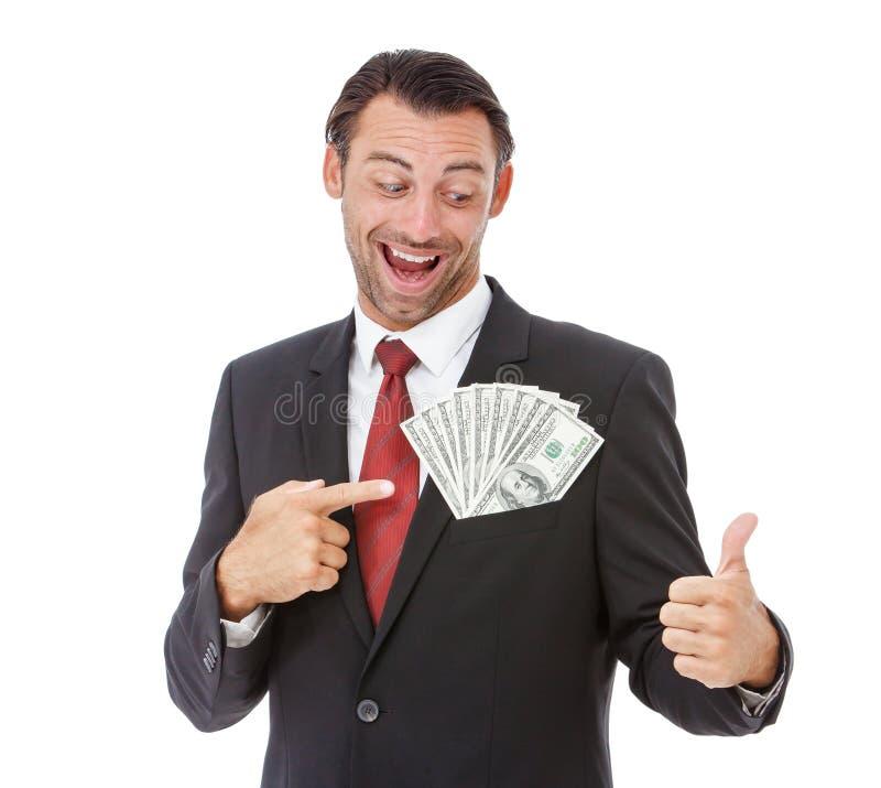Hombre de negocios sonriente que sostiene el dinero imagenes de archivo