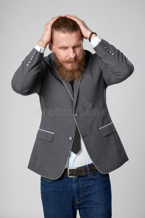 Hombre de negocios subrayado descontento del inconformista foto de archivo