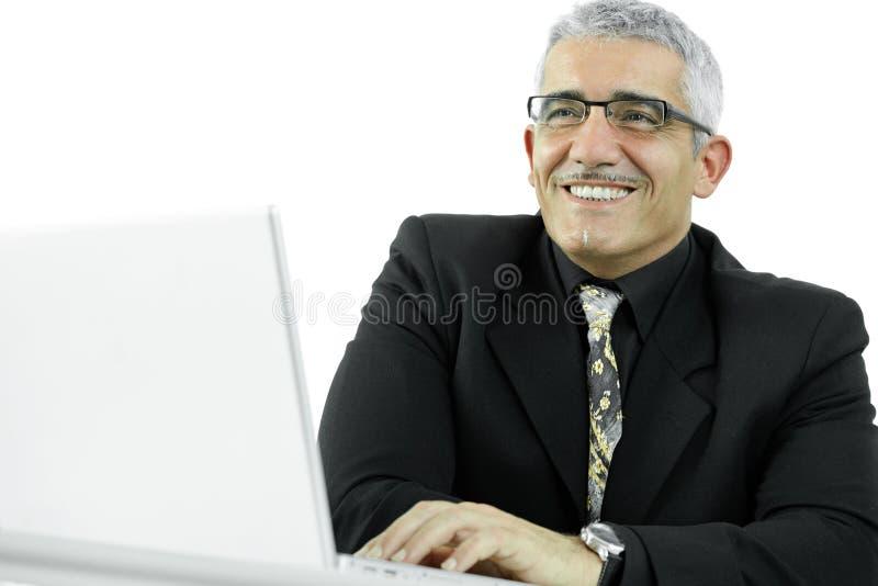 Hombre de negocios usando el ordenador portátil imagen de archivo libre de regalías