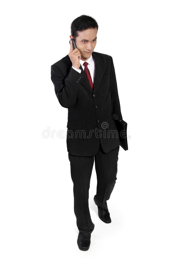 Hombre de negocios usando el teléfono celular foto de archivo libre de regalías