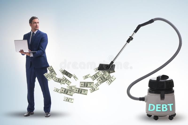 Hombre de negocios y aspirador que chupa el dinero fuera de él imágenes de archivo libres de regalías