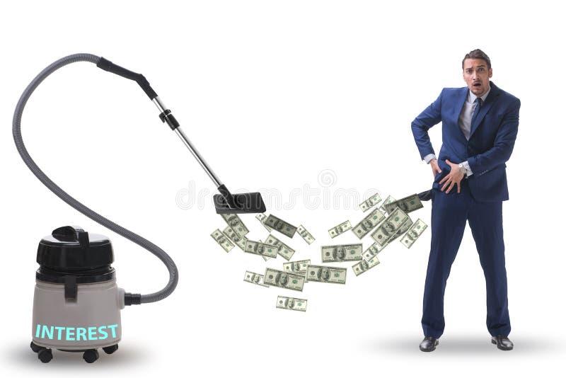 Hombre de negocios y aspirador que chupa el dinero fuera de él imagen de archivo