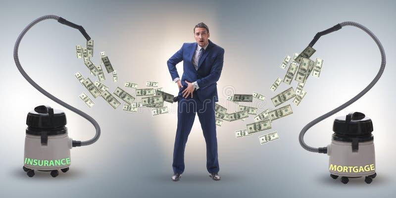 Hombre de negocios y aspirador que chupa el dinero fuera de él fotos de archivo