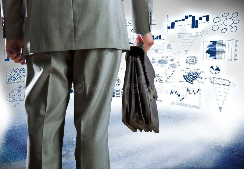 Hombre de negocios y bosquejos del negocio imagen de archivo libre de regalías