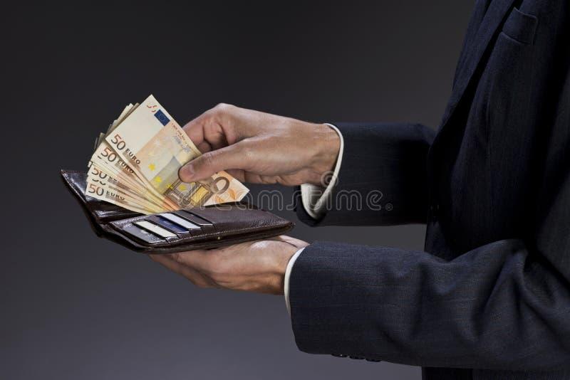 Hombre de negocios y cartera imagen de archivo libre de regalías