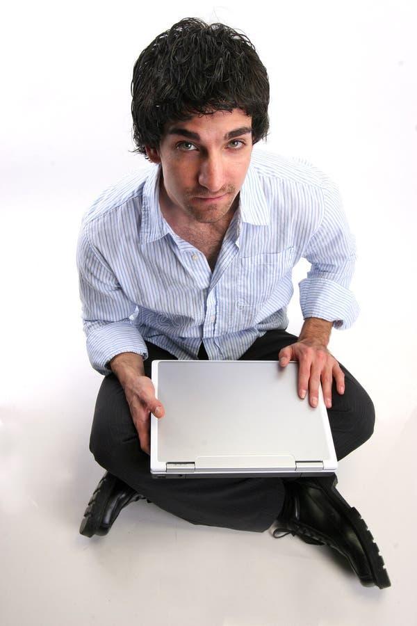 Hombre de negocios y computadora portátil fotos de archivo libres de regalías