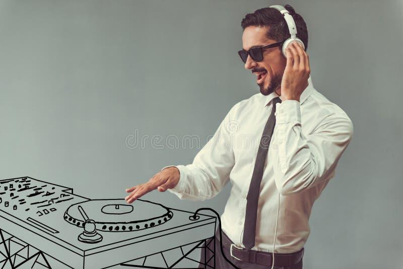 Hombre de negocios y DJ hermosos fotografía de archivo