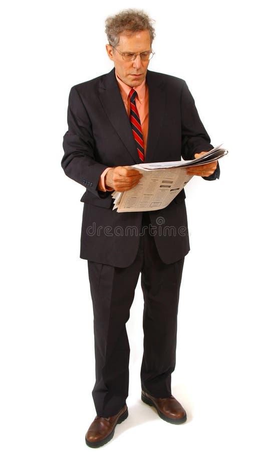 Hombre de negocios y periódico foto de archivo libre de regalías