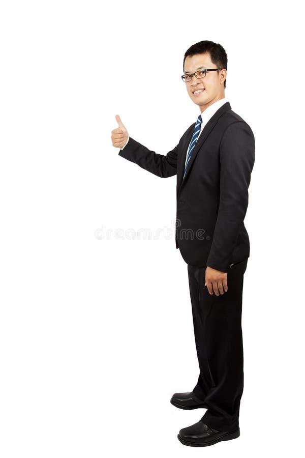 Hombre de negocios y pulgar jovenes para arriba fotografía de archivo libre de regalías