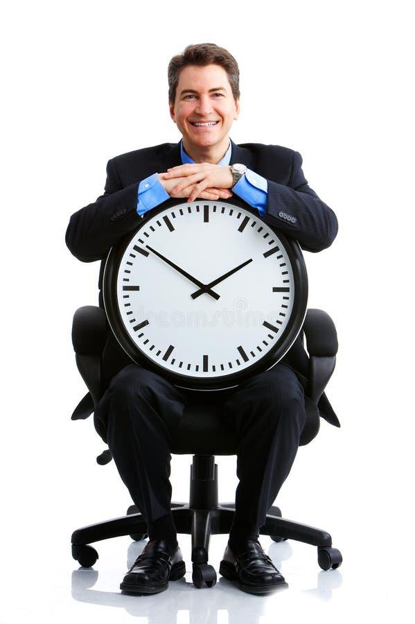 Hombre de negocios y reloj imagen de archivo