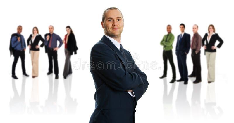 Hombre de negocios y sus personas foto de archivo