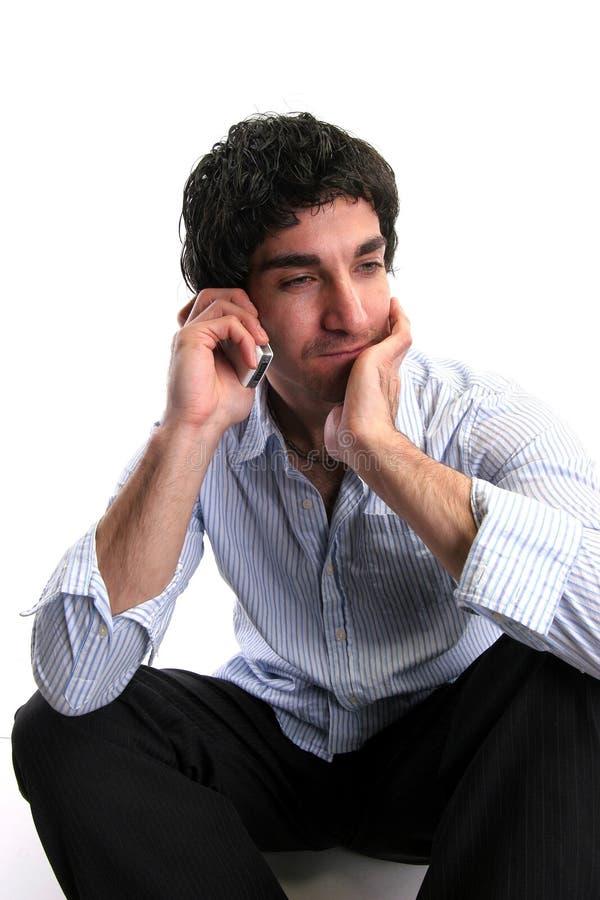 Hombre de negocios y teléfono celular fotos de archivo libres de regalías