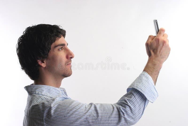Hombre de negocios y teléfono celular imágenes de archivo libres de regalías