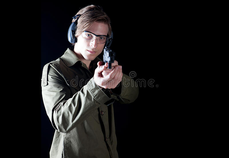 Hombre del arma imagen de archivo