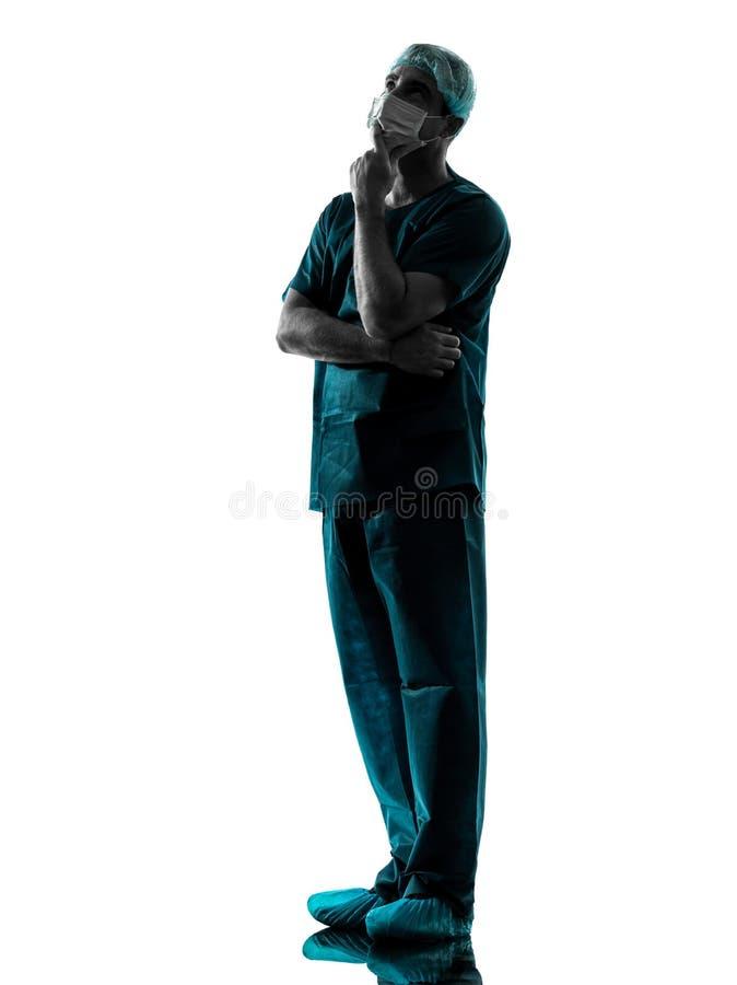 Hombre del cirujano del doctor con la silueta de la mascarilla imagen de archivo libre de regalías