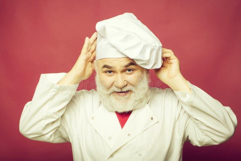 Hombre del cocinero en sombrero del cocinero fotografía de archivo libre de regalías
