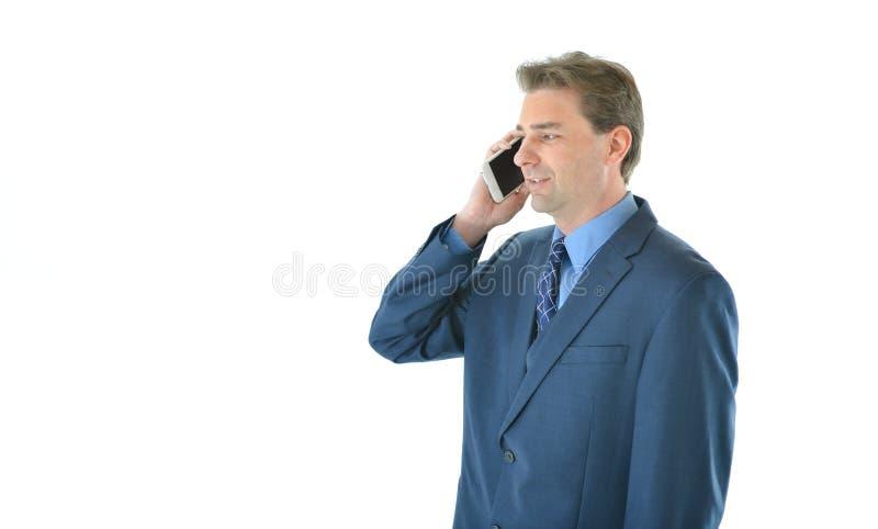 Hombre del negocio o de las ventas en el teléfono fotografía de archivo