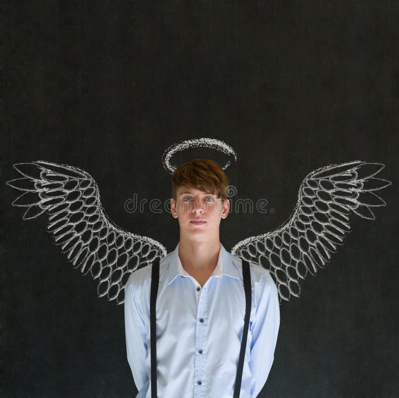 Hombre del inversor del ángel del negocio con las alas y halo de la tiza fotografía de archivo libre de regalías