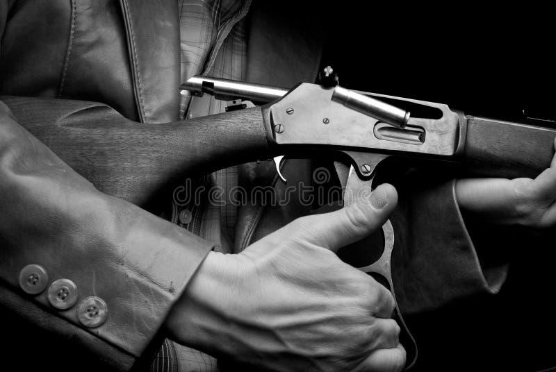 Hombre del rifle imagen de archivo libre de regalías