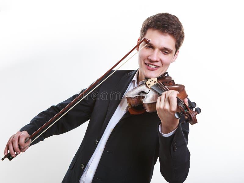 Hombre del hombre vestido elegante tocando el violín imagen de archivo