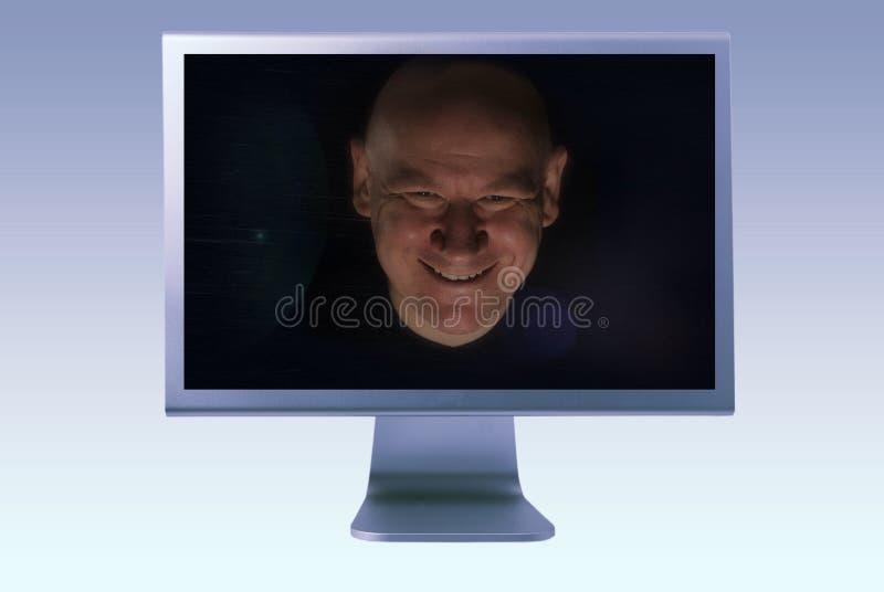 Hombre dentro de la pantalla del ordenador TV imagen de archivo libre de regalías
