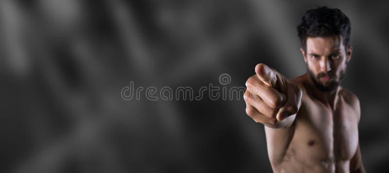Hombre descamisado que señala su finger en usted imágenes de archivo libres de regalías