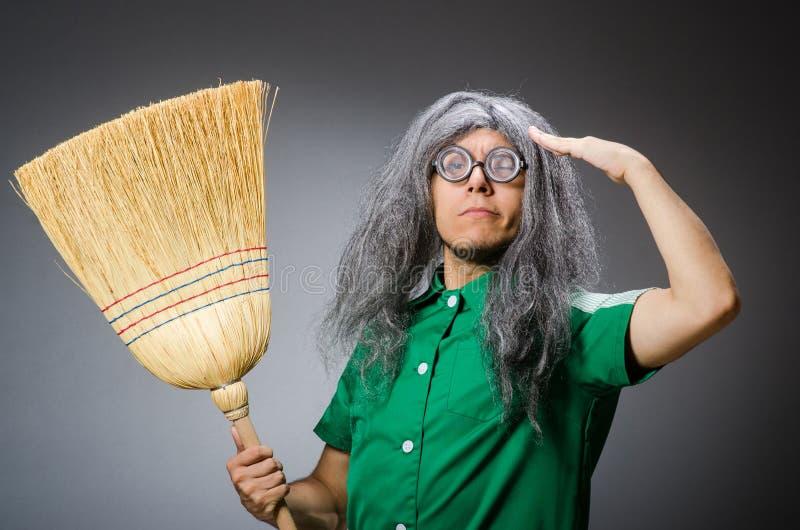 Hombre divertido con el cepillo fotografía de archivo libre de regalías