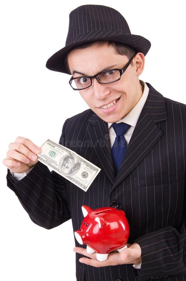 Hombre divertido con el piggybank imagen de archivo libre de regalías