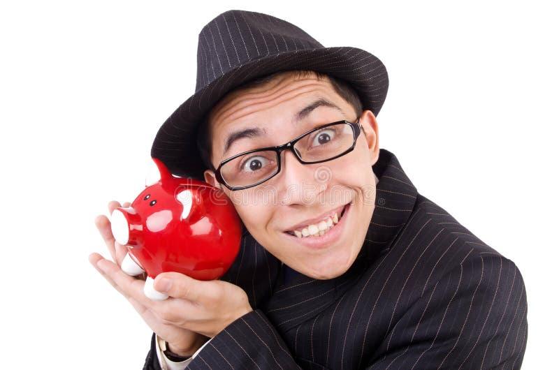 Hombre divertido con el piggybank foto de archivo
