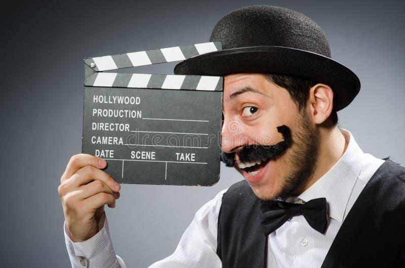 Download Hombre Divertido Con La Chapaleta De La Película Foto de archivo - Imagen de clapperboard, divertido: 41914270