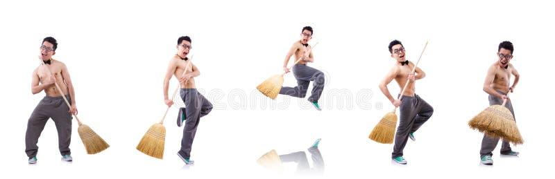 Hombre divertido con la escoba en blanco fotografía de archivo libre de regalías