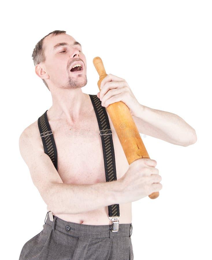 Hombre divertido del empollón que se divierte con el rodillo aislado foto de archivo libre de regalías