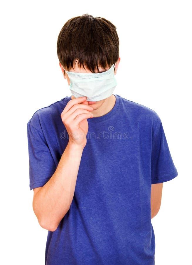 Hombre divertido en máscara de la gripe fotografía de archivo