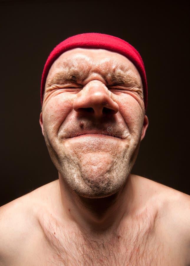 Hombre divertido muy tensionado foto de archivo libre de regalías