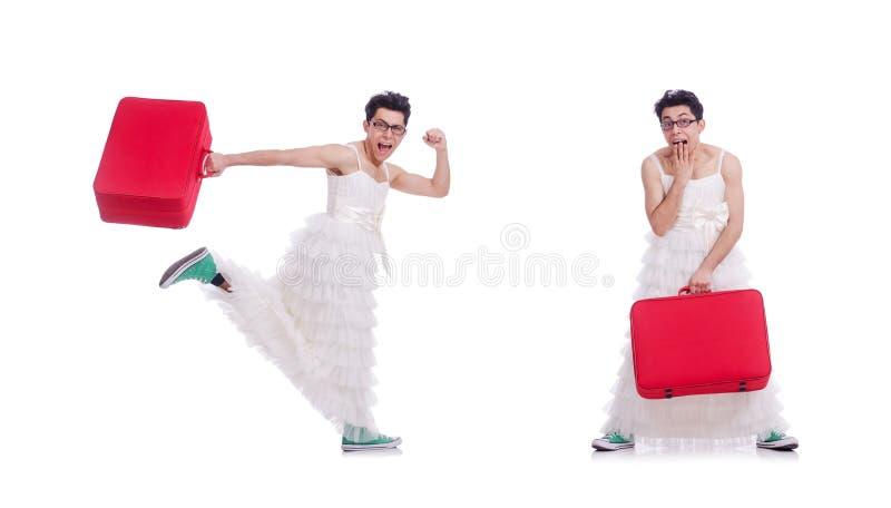 Hombre divertido que lleva en el vestido de la mujer que se prepara de vacaciones aislado imagen de archivo libre de regalías
