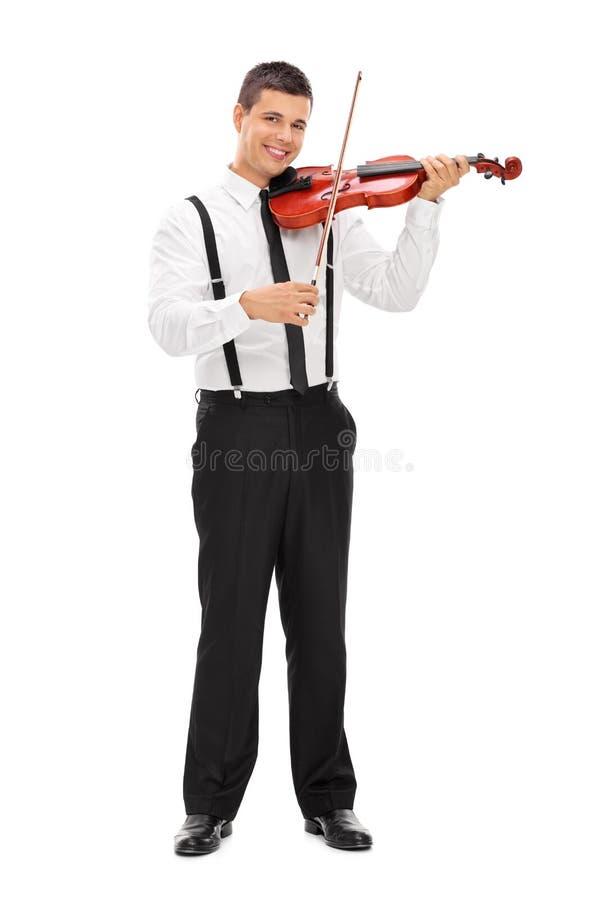 Hombre elegante joven que toca un violín fotos de archivo libres de regalías