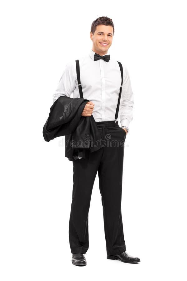 Hombre elegante que lleva su capa y presentación imagenes de archivo