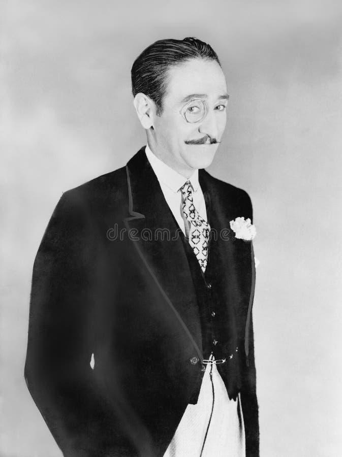 Hombre elegante vestido con un monóculo (todas las personas representadas no son vivas más largo y ningún estado existe Garantías imágenes de archivo libres de regalías