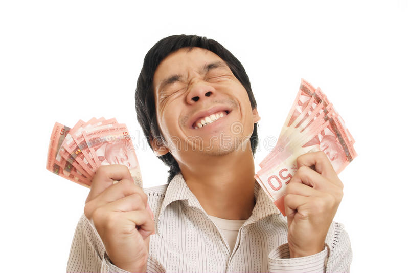 Hombre emocionado con el dinero foto de archivo libre de regalías