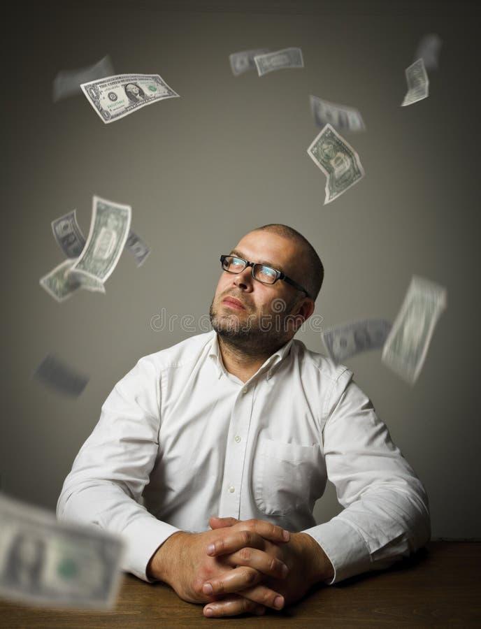 Hombre en blanco y dólares imágenes de archivo libres de regalías